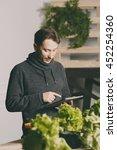 handsome modern grower using... | Shutterstock . vector #452254360