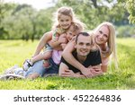 family playing in the park on... | Shutterstock . vector #452264836
