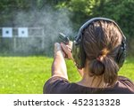 Girl Shooting With A Gun On A...