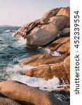 shoreline rocks at sunset near... | Shutterstock . vector #452339554