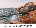 shoreline rocks at sunset near... | Shutterstock . vector #452339578