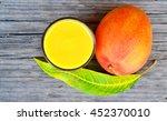 fresh mango smoothie ripe mango ... | Shutterstock . vector #452370010
