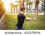 working out with resistance band | Shutterstock . vector #452378956
