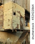 Small photo of Old ruined house with earthen walls and adobe plaster