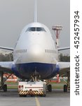 Small photo of MOSCOW, RUSSIA - SEPTEMBER 26, 2014: Boeing 747 Transaero towed to the runway. Transaero Airlines has ceased to exist in 2015.