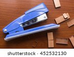 Blue Stapler And Piles Of...