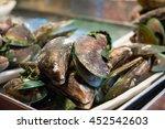 mussels at street market night. | Shutterstock . vector #452542603