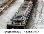 Flatcar full of new train wheel and axle sets - stock photo