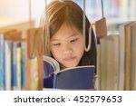 little asian girl reading a... | Shutterstock . vector #452579653