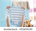 female hand holding baby...   Shutterstock . vector #452654140