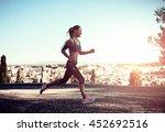 smiling female jogger training...   Shutterstock . vector #452692516