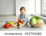 Cute Baby Girl With Vegetables...