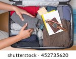 man's hands are packed suitcase ... | Shutterstock . vector #452735620