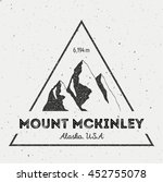 McKinley in Alaska, USA outdoor adventure logo. Triangular mountain vector insignia. Climbing, trekking, hiking, mountaineering and other extreme activities logo template.
