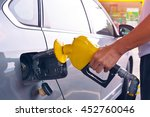 hand holding fuel nozzle to add ... | Shutterstock . vector #452760046