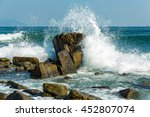 Powerful Waves On A Rocky Beach