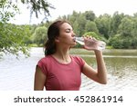 young woman drinking water... | Shutterstock . vector #452861914