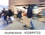 a shopper walking past a store... | Shutterstock . vector #452899723