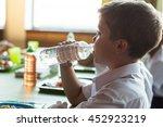 close up of schoolboy drinking...   Shutterstock . vector #452923219