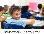 portrait of smiling boy with... | Shutterstock . vector #452924290