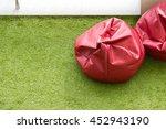 soft beanbag seats on green... | Shutterstock . vector #452943190