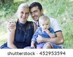 young happy family the park | Shutterstock . vector #452953594