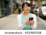 young asian woman walking... | Shutterstock . vector #452985538