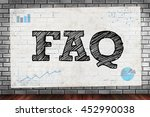 Small photo of FAQ abbreviation ( frequently asked questions ) on brick wall and poster concept