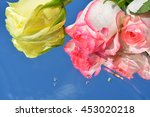 Roses On Water Background