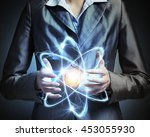 atom molecule in hands . mixed...