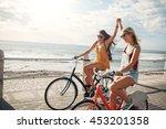 female friends enjoying cycling ... | Shutterstock . vector #453201358