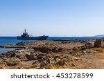 Grey Modern Warship Sailing In...