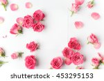 Stock photo framework from roses on white background flat lay 453295153