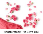 Stock photo assorted roses heads various soft roses and leaves scattered on a white background overhead view 453295183