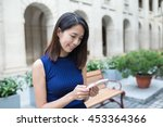 woman using cellphone at outdoor | Shutterstock . vector #453364366