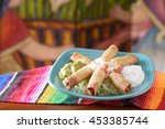 Small photo of Traditional Mexican food taquito platter with copy space