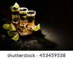 mexican gold tequila with lime... | Shutterstock . vector #453459538