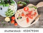 Cooking Greek Salad  Cutting...