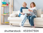 carefree woman using computer... | Shutterstock . vector #453547504