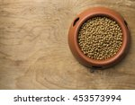 dog food on wood table | Shutterstock . vector #453573994