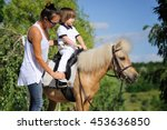 Small photo of First lessons of horseback riding