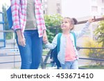 parent taking child to school | Shutterstock . vector #453671410