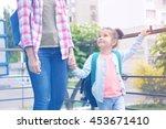 parent taking child to school | Shutterstock . vector #453671410