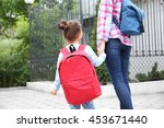 parent taking child to school | Shutterstock . vector #453671440