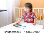 lovely baby painting with wax... | Shutterstock . vector #453682900