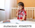 lovely baby boy painting with... | Shutterstock . vector #453682978