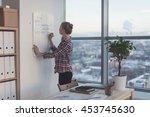 businesswoman writing day plan... | Shutterstock . vector #453745630