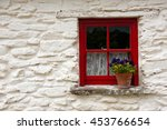 Red Window On The White Wall O...