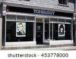 Small photo of TRURO, CORNWALL, UK - JULY 17, 2016: Toni and Guy Hair Salon Window Store. Front of Toni&Guy beauty shop with advertizing . British high street. Editorial Use Only.