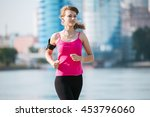 sporty woman running in the city | Shutterstock . vector #453796060